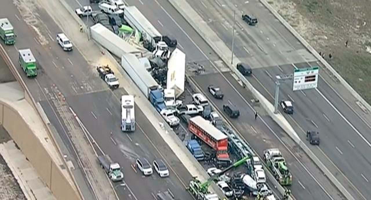 Buzlanan yolda 130 araç birbirine girdi! Ölü ve yaralılar var